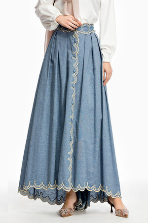 Designed by HIJAB-HOUSE Australia  This washed-blue denim maxi skirt is cut to form a romantic silhouette that flares onto the floor, the scallop trim is outlined with embroidery stitching. Non-sheer.