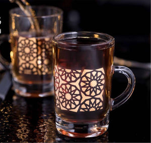 Inspired by the city of Cairo, these teacups was created with artistic Arabesque design. Shining gold along with perforated glass combine to create this unique décor