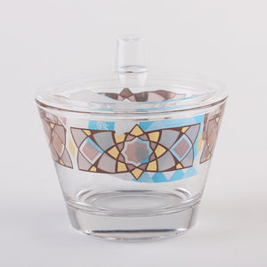 The beautiful colors of this interweave design tell stories and tales in a modern style which shines with magic and breathes life  This beautiful Glass Small Bowl is part of Cristi collection. comes with an acrylic cover. Great for dates, nuts, sugar...etc  Gold& Brown Made in Jordan Includes Bowl & lid  Care Handwash recommended