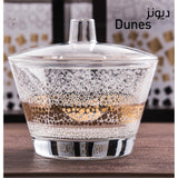 Inspired by the magical movement of the dunes, with white and golden sands.  Great as a housewarming gift Imported Includes 20 PCS (6 coffee cups, 6 teacups, 6 saucers and 1 sugar bowl with lid)  Care instructions