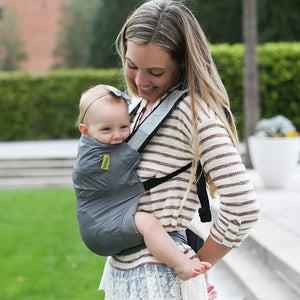 Mother wearing baby in grey Boba Air light weight soft structured baby carrier.