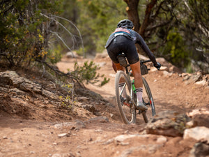Heather Jackson riding Boken Doublecross on single track in Utah