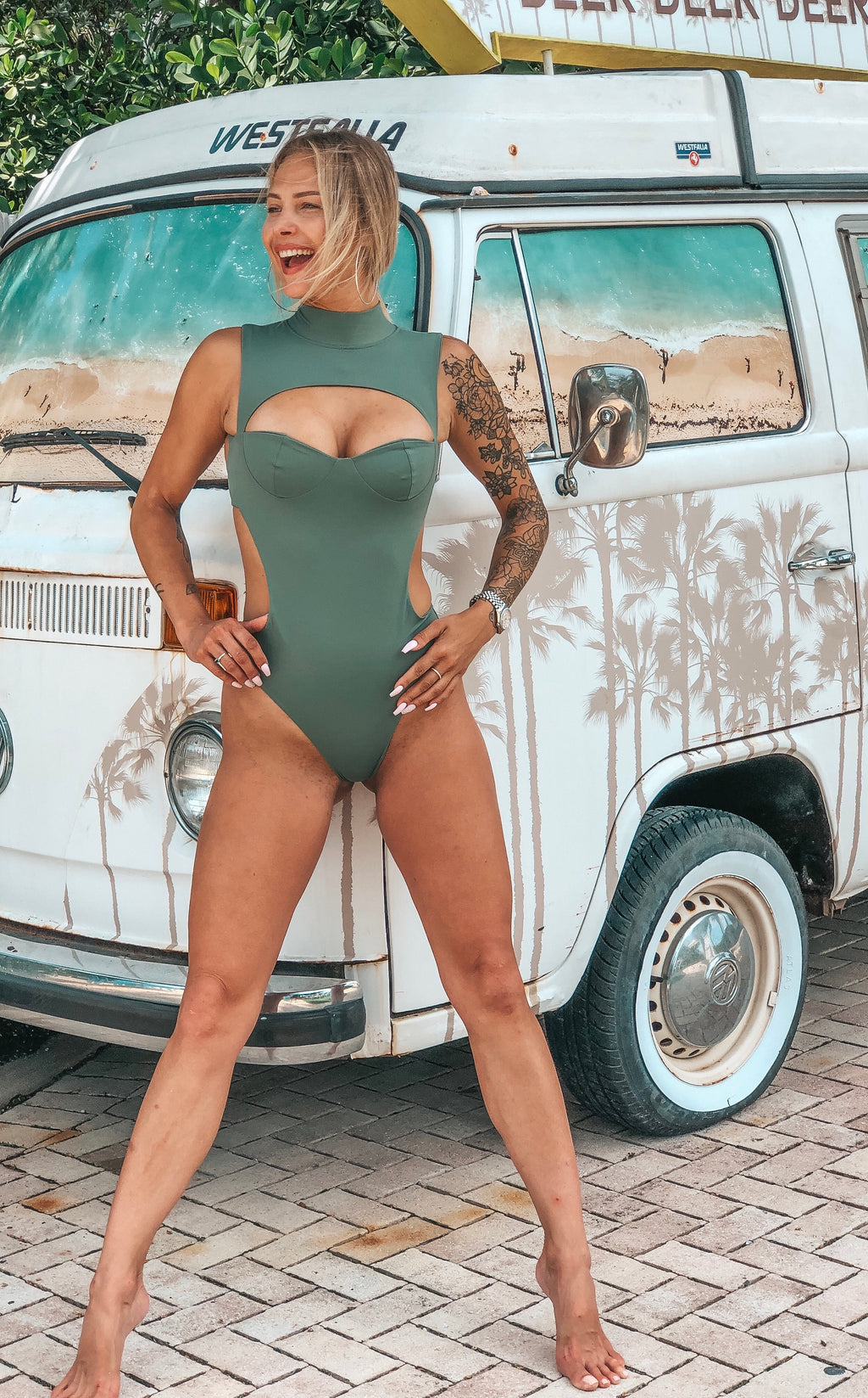 Olive green one piece swimsuit with cut outs and built in bra