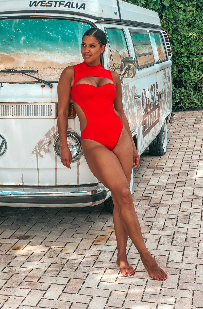 Red one piece swimsuit with cut outs and built in bra