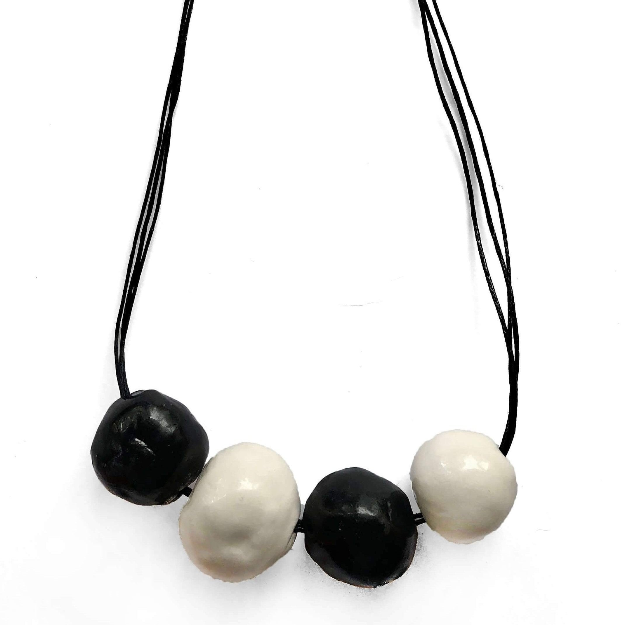 Black and white ceramic necklace with four beads