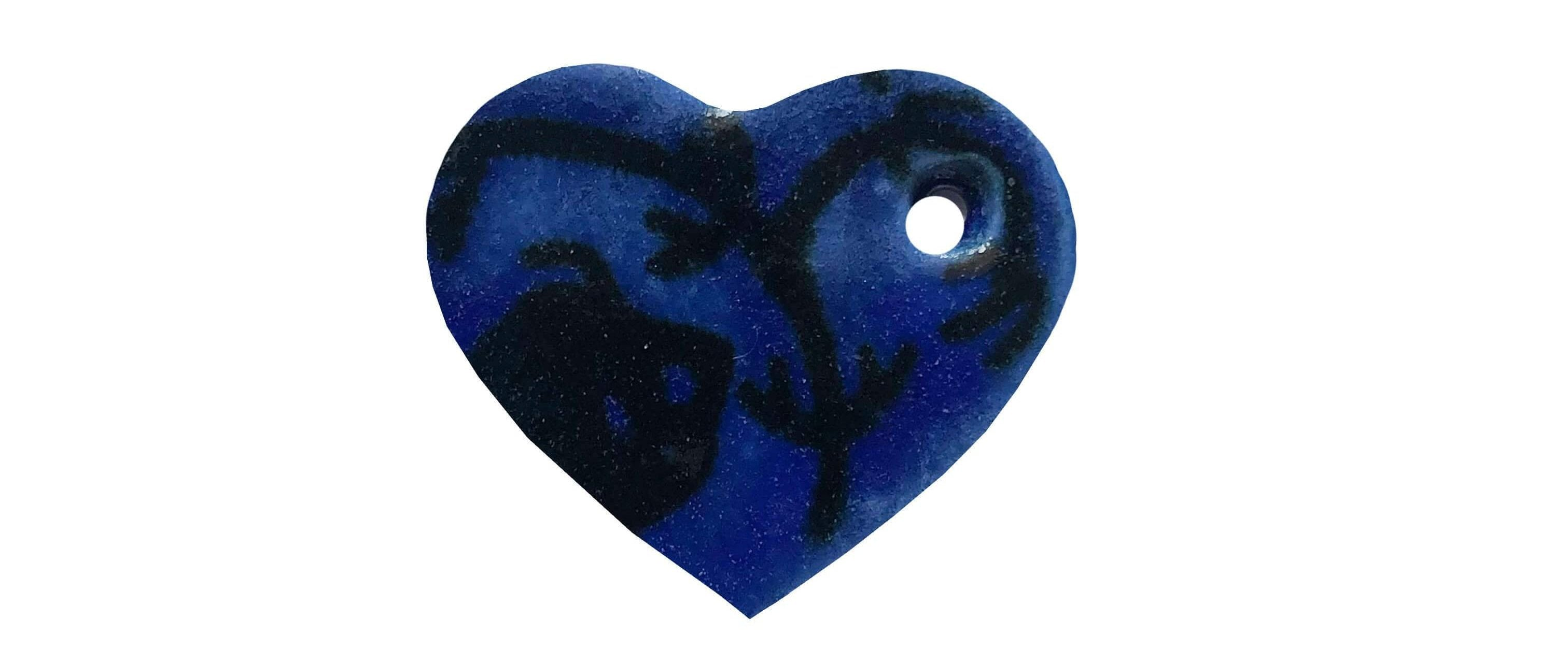 Blue and black heart-shaped ceramic dog name tag