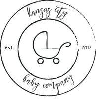 kansas city baby co circular logo with a stroller outline in the middle kansas city baby co