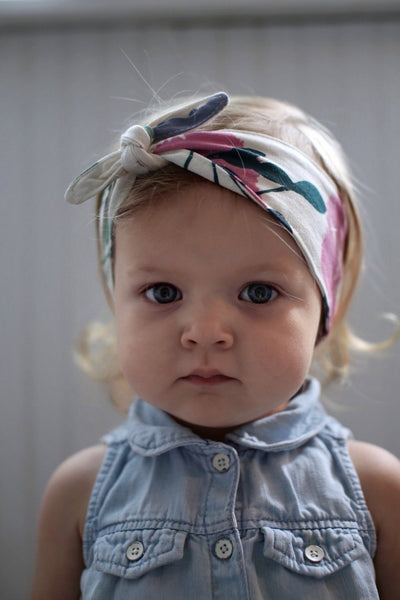 blonde haired toddler girl wearing floral owl + mouse head wrap kansas city baby co