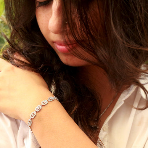 Boxy trinket sterling silver bracelet is one bracelet that glams-up almost anything in your wardrobe.