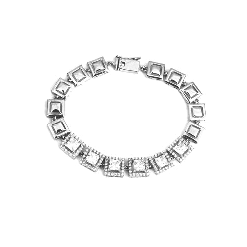 Dazzling silver charm bracelet is made with with cubic zirconia stones and 925 sterling silver. Best pick for any occassion.