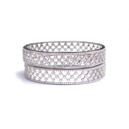 Ethereal Cubic Zirconia Bangles are traditional enough to be donned at weddings or special occasions