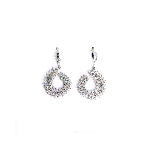 Round shape transparent cubic zirconia 92.5 silver earring is an elegant choice for party wear.
