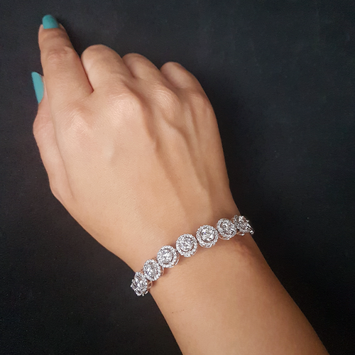 The handmade 92.5 silver bracelet is made with round zircon stones and 925 silver. Ideal for casual and indian attires.