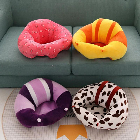 Image of baby sitting pillow