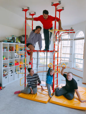 Monkey Bars and Model T1 Home Play Jungle Gym for kids. Includes gymnastics rings, climbing rope, wooden swing, climbing rope net. Additionally equipped with a metal curved ladder. Floor-to-ceiling tension mounted and extended to fit 10ft ceiling.