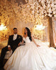 Gorgeous 2020 Sheer Long Sleeve Wedding Gowns Beadings Deep V-Neck Satin Bridal Ball Gown