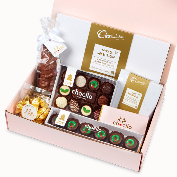 Chocilo Melbourne Christmas Hamper with assorted couverture chocolate including plum puddings, caramels, chocolate santa, foiled stars. Chocolatier Australia chocolate gift boxes.