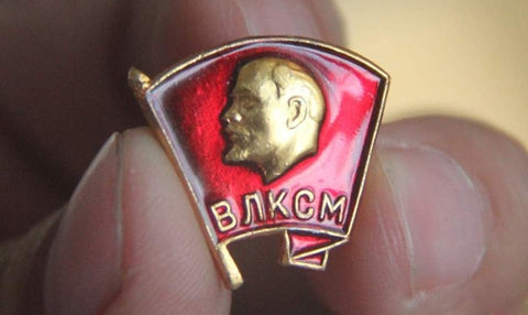 Russian USSR Lenin Pin with a red flag and russian text