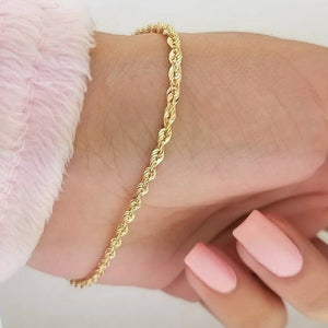 2mm gold rope chain bracelet displayed on a womans wrist