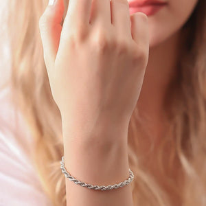 4mm silver rope chain bracelet displayed on a woman's wrist