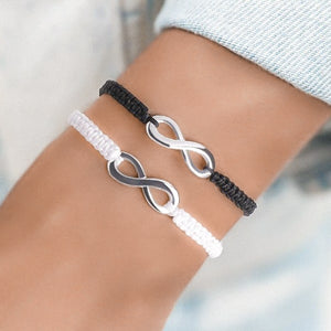 Woman wearing a black and white infinity bracelet set