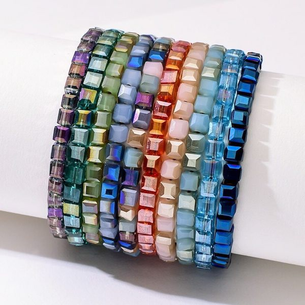 A stack of square crystal bead bracelets