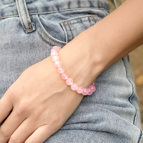 Beaded rubellite pink tourmaline bracelet on a woman's wrist