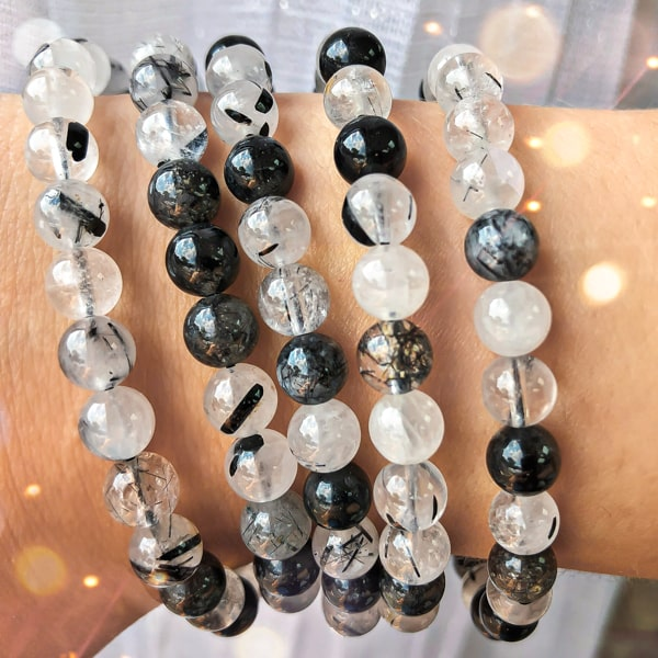 Beaded tourmaline rutilated quartz bracelet on a woman's wrist