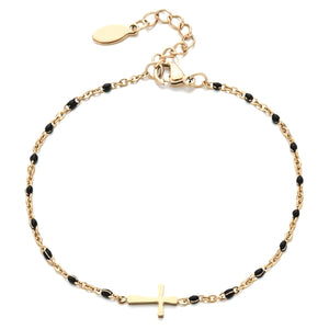Gold cross bracelet with black beads