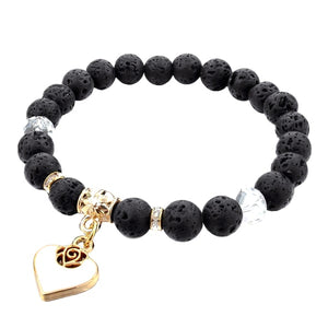 Beaded black lava stone bracelet with a gold heart charm