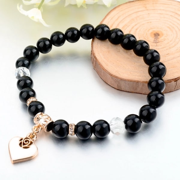 Black natural stone bracelet with gold heart charm