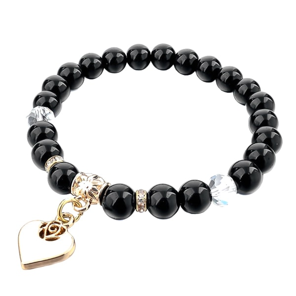 Beaded black obsidian bracelet with a gold heart charm