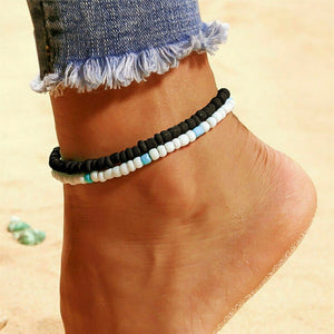 Black handmade beaded anklet on a womans ankle