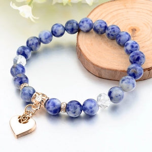 Blue natural stone bracelet with a gold heart charm