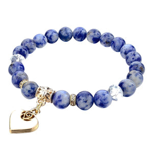 Beaded blue sodalite bracelet with a gold heart charm