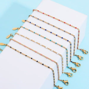 Thin gold chain bracelet with blue beads