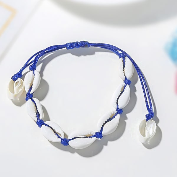 Blue cowrie shell ankle bracelet detailed close up