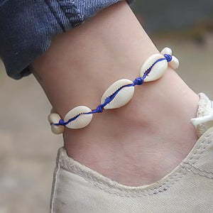 Blue cowrie shell anklet on a womans ankle