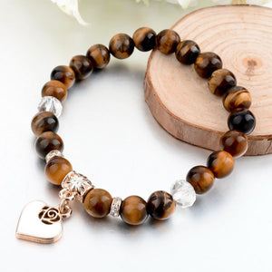 Brown natural stone bracelet with a gold heart charm