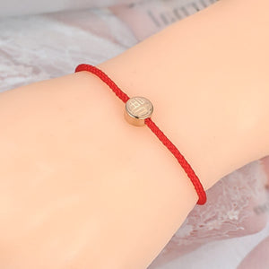 Chic red rope bracelet on woman's wrist