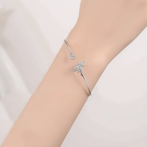 Woman wearing a dragonfly cuff bracelet on her wrist