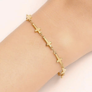 Woman wearing a gold cross chain bracelet