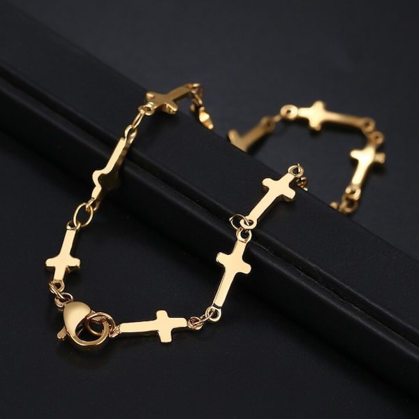 Cross chain bracelet made of gold-toned stainless steel