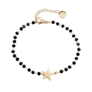 Gold star bracelet with black beads