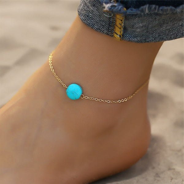 Gold ankle bracelet with turquoise stone detail