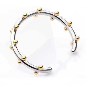Gold & silver beaded cuff bracelet viewed from its side