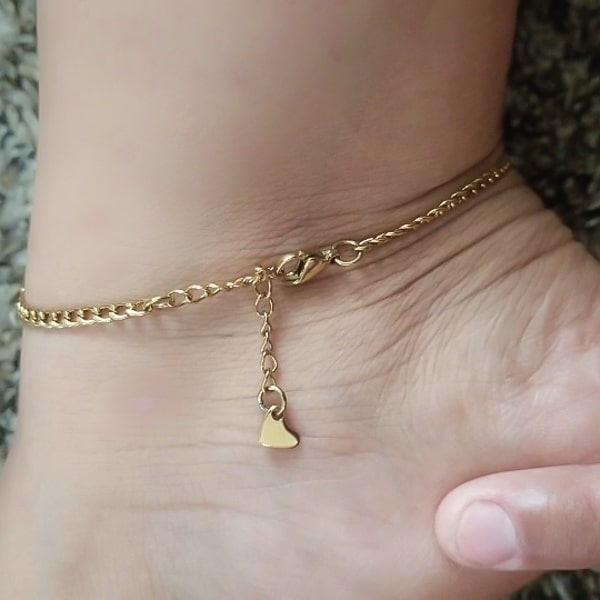 Gold curb chain anklet displayed on a womans ankle