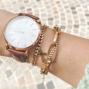 Gold dual chain bracelet on a woman's wrist