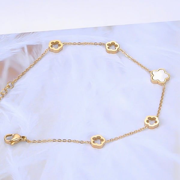 Gold flower chain bracelet close up details