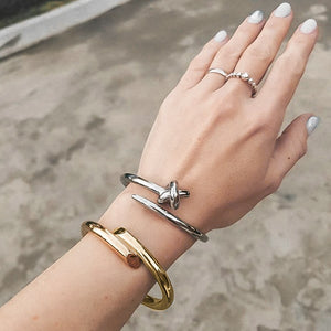 Gold harmony cuff bracelet on a woman's wrist